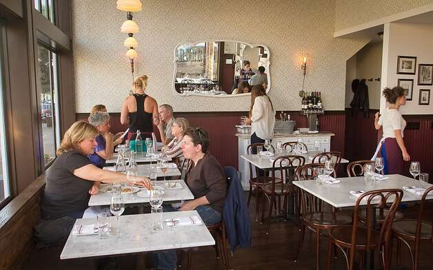People enjoy dinner at  Local's Corner restaurant in San Francisco, Calif., on Friday, June 15th, 2012. Photo: John Storey, Special To The Chronicle
