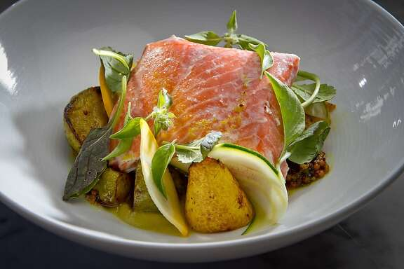 King Salmon with Vadouvan, Squash and Mustard Greens at Local's Corner restaurant in San Francisco, Calif., is seen on Friday, June 15th, 2012.