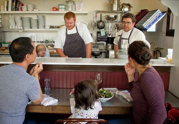 Chef Jake Des Voignes talks to a family sitting at the counter at Local's Corner restaurant in San Francisco, Calif., on Friday, June 15th, 2012. Photo: John Storey, Special To The Chronicle