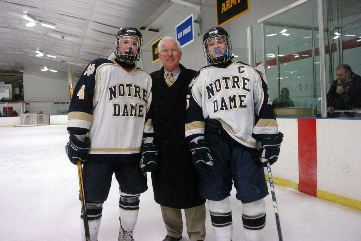 Notre Dame of Fairfield Head Coach Marty Roos stands with his grandsons Tyler and Chris Schmarr, right, after Roos got his 500th game win after beating Danbury on Thursday January 15, 2009.