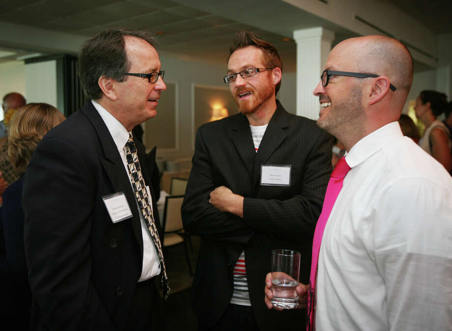 From left; Fairfield County Public Relations Association incoming Co-President Randy Sawicki talks with keynote speakers Adam Smith and Luke Scott at the group's Annual Meeting and Networking Event at the Shore & Country Club in Norwalk on Wednesday, June 20, 2012. Photo: Brian A. Pounds / Connecticut Post