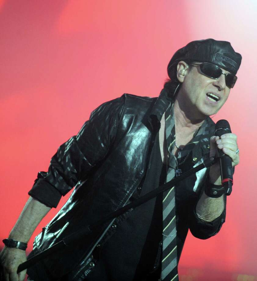 Klaus Meine  will keep Scorpions on the road as long as this crazy world needs them. Photo: FRED TANNEAU, AFP/Getty Images / 2011 AFP