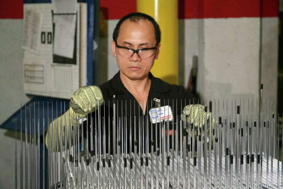 Goodman Global, a manufacturer of residential and commercial heating and cooling products and systems, was named to the list of top private companies in Houston in the Chronicle 100. Orlando Caval, fin press operator at the Goodman cooling facility, checks aluminum components of an air conditioner s condenser coil. Photo: Courtesy Photo