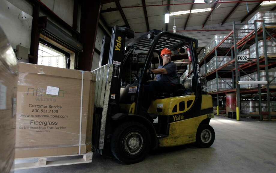 Vincent Martinez, a material handler, at Nexeo Solutions, 8901 Old Galveston Road, uses a forklift to move a carton of product  Tuesday, June 5, 2012, in Houston. ( Melissa Phillip / Houston Chronicle ) Photo: Melissa Phillip / © 2012 Houston Chronicle