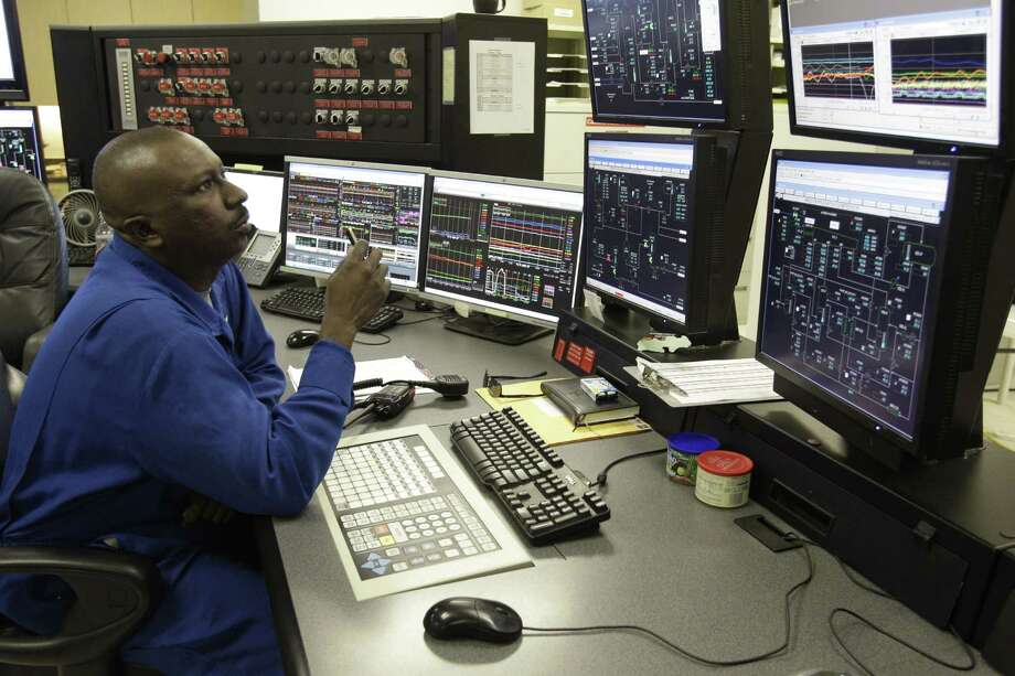 Darnell Moses, a process technician, works in the control room at PetroLogistics, 9822 La Porte Freeway, Thursday, June 7, 2012, in Houston.  ( Melissa Phillip / Houston Chronicle ) Photo: Melissa Phillip / © 2012 Houston Chronicle