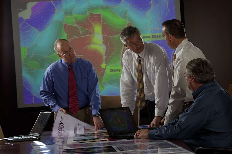 (From left to right) Energy XXI's Allen Berlin, Ron vanMourik, Mark Fanning and Joe Ozment reviewing a structure map of the Davy Jones Wilcox.   Energy XXI is an independent oil and natural gas exploration and production company whose growth strategy emphasizes acquisitions, enhanced by its value-added organic drilling program.  Energy XXI will be recognized in the Chronicle 100 special section. Photo: NA
