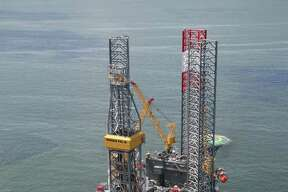The Rowan EXL III rig working a platform on Grand Isle for Energy XXI. Energy XXI is an independent oil and natural gas exploration and production company based in Houston. It is being recognized in the Chronicle 100 special section.
