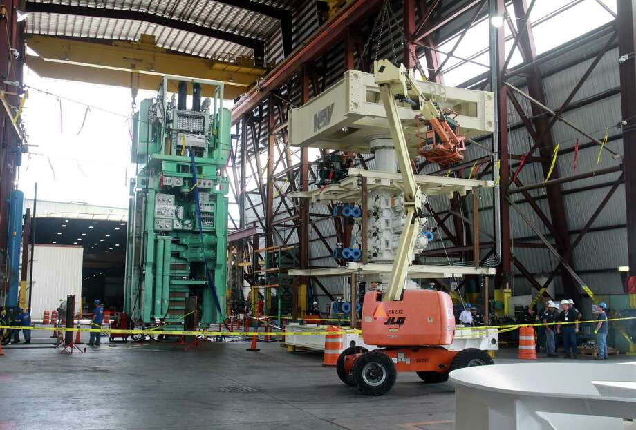 (For the Chronicle/Gary Fountain, June 4, 2012)  National Oilwell Varco employees working on BOP (blowout preventer) stacks. Photo: Gary Fountain / Copyright 2012 Gary Fountain.