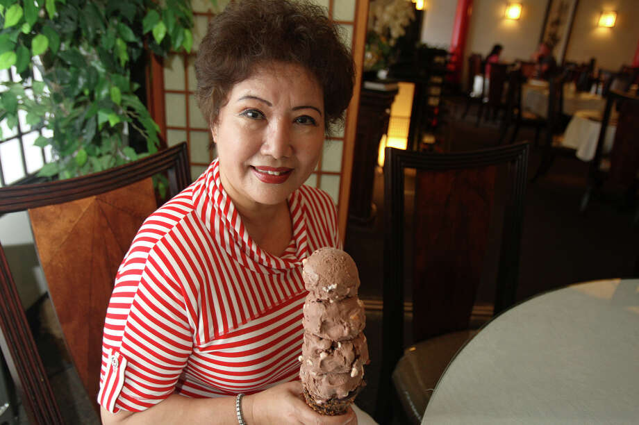 Chef Young Cacy with her favorite guilty pleasure, rocky road ice cream on June 18, 2012 at Il Song Garden. Photo: Julysa Sosa, San Antonio Express-News / SAN ANTONIO EXPRESS-NEWS