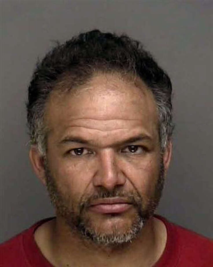 Guillermo Rivera, a Bridgeport man with a lengthy criminal record was arrested on sexual-assault charges Tuesday, Jan. 24, 2012 after police said he was linked by DNA to a rape outside the city train station in June 2010. Rivera, 44, of Denver Avenue, was charged with first-degree sexual assault and aggravated first-degree sexual assault and was being held in lieu of $200,000 bond. On Thursday, June 21, he pleaded guilty and faces up to 15 years in jail. Photo: Contributed Photo / Connecticut Post Contributed