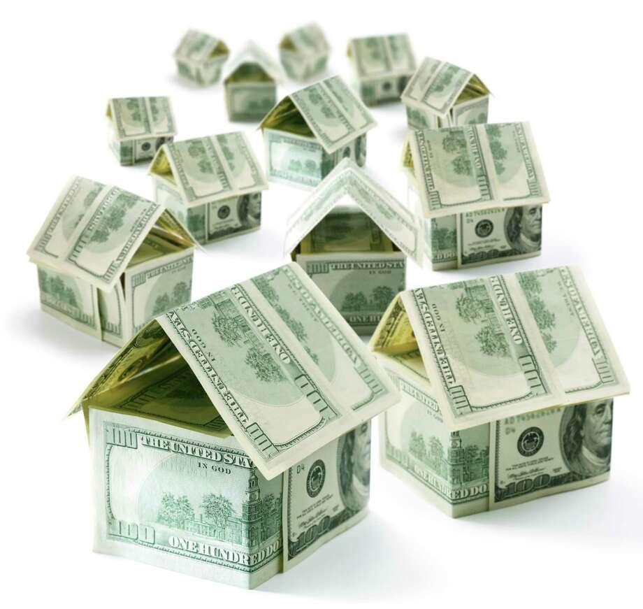 Refinancing a home loan can save big bucks. (Fotolia.com) Photo: Valentyn Volkov / volff - Fotolia