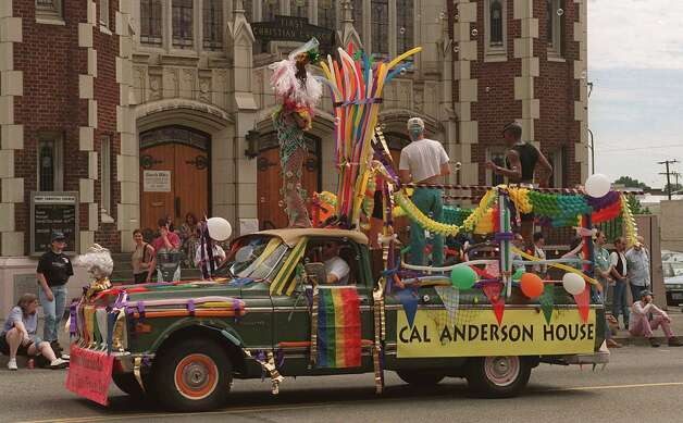 1996: An old pickup served as a float for the Cal Anderson House during the Gay Pride parade on Seattle's Capitol Hill. Photo by Loren Callahan Photo: Seattlepi.com Photos