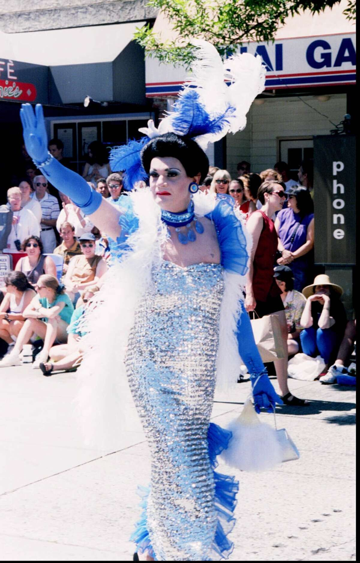 1995: A gay pride parade Participant waves to the crowd on Broadway. Photo by Loren Callahan.