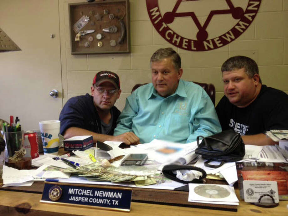 Sheriff Mitchel Newman (center) with the JCSO Narcotics Team Joe Sterling (left) and Scott Duncan (R) Photo: Jodie Warner