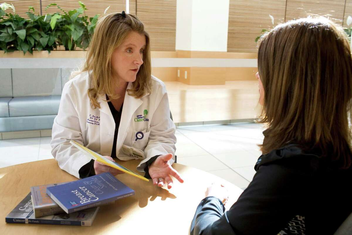 Teresa Money McLaughlin, director of integrative oncology at St. VincentâÄôs Medical Center in Bridgeport, Conn. meets with a patient in the Cancer Center waiting area. Nurse navigators help people through chronic disease management.