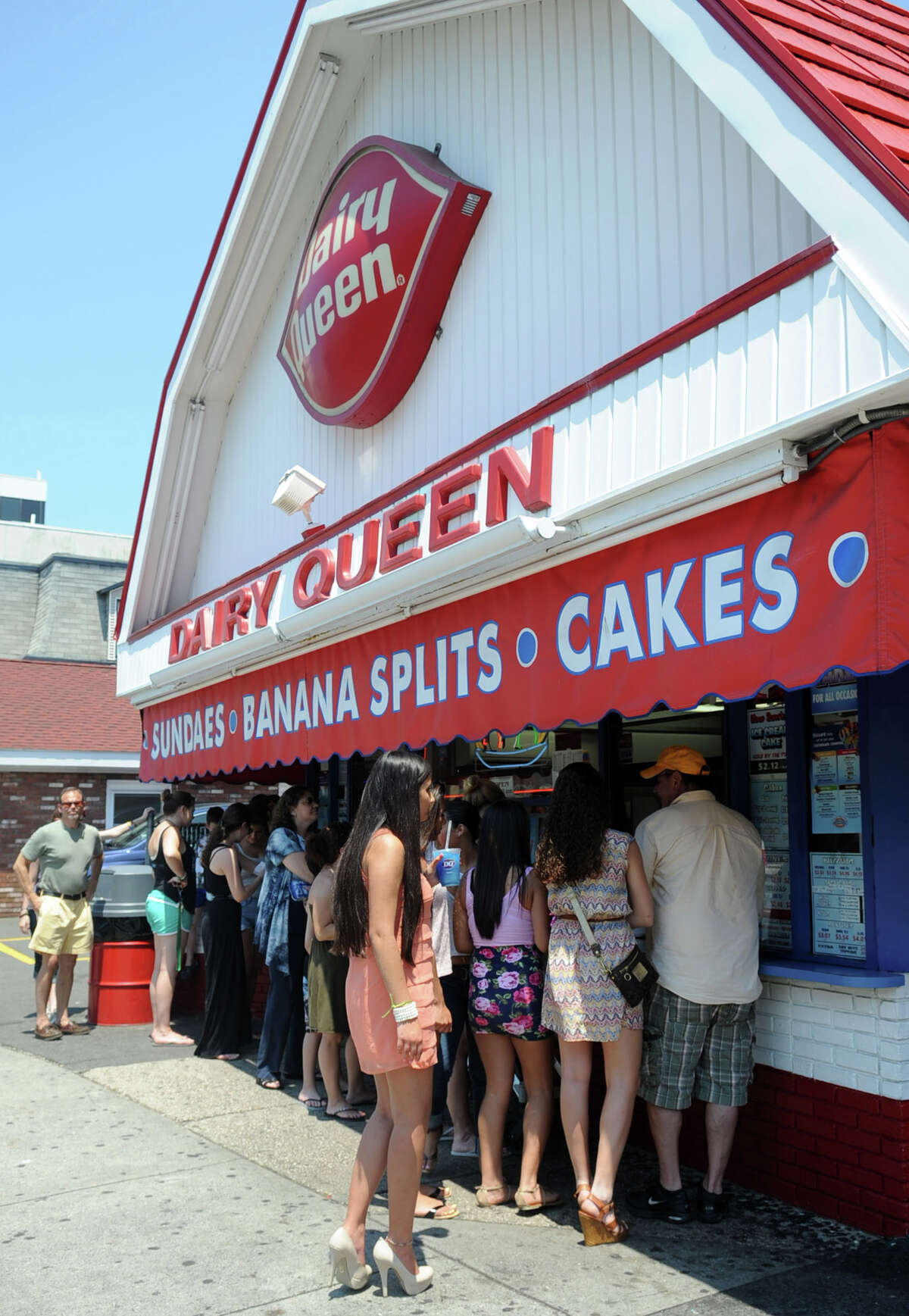 People line up to beat the heat at Dairy Queen in Stamford on Thursday, June 21, 2012.