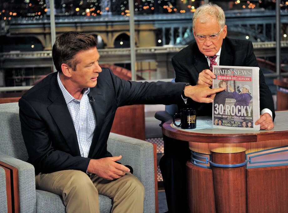 In this photo provided by CBS Entertainment, David Letterman holds a copy of the Daily News as guest Alec Baldwin gestures to the front page showing a photo of his June 6th confrontation with a photographer, during his appearance on the Late Show with David Letterman, in New York, Wednesday, June 20, 2012. (AP Photo/CBS Entertainment, John Paul Filo) Photo: John Paul Filo