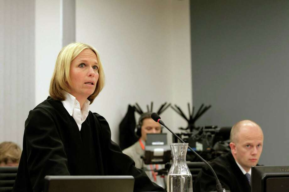 Prosecutors Inga Bejer Engh, left, and Svein Holden deliver their closing arguments in the trial against Anders Behring Breivik, the confessed gunman who killed 77 people last year in a bomb and shooting rampage, unseen, in the court in Oslo, Norway Thursday June 21, 2012.     (AP Photo/Berit Roald/Scanpix NTB POOL) Photo: Roald, Berit