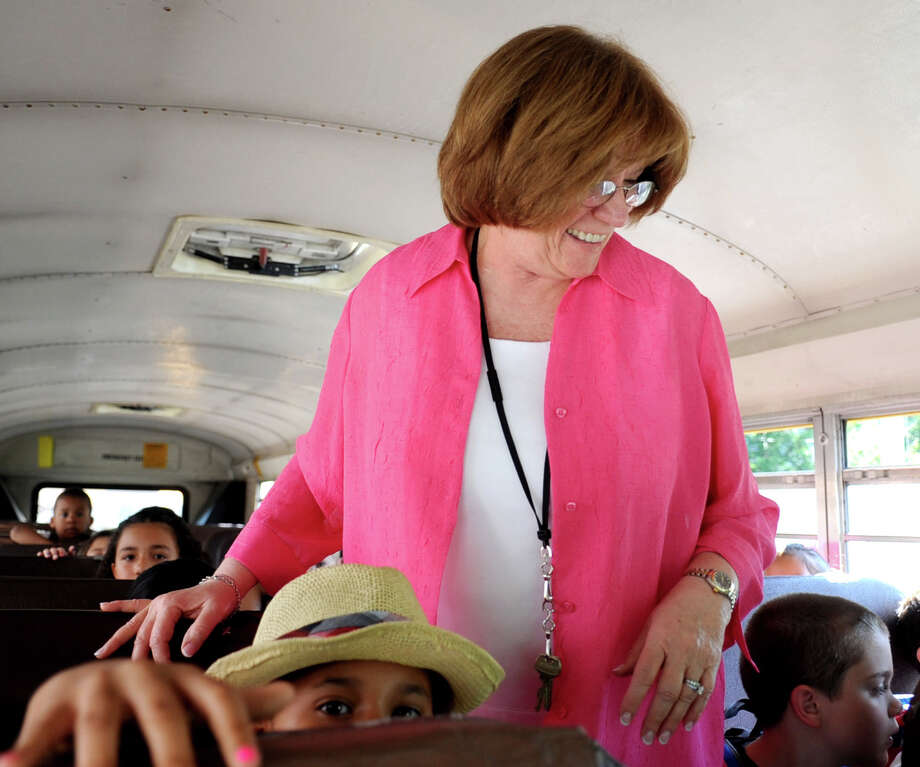 Cathy Macchio greets students as they arrive at Stark School on busses on Thursday, June 21, 2012. Macchio is retiring as assistant principal. Photo: Lindsay Niegelberg / Stamford Advocate