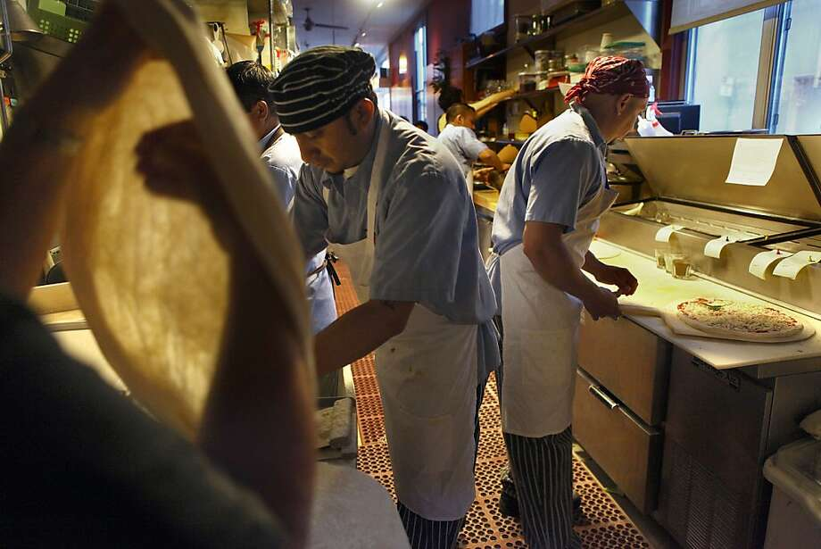 Owner Sharon Ardiana (far left) working on pizza dough as Juan Chuc (middle) and Pedro Chuc (right) make pizza at Gialina in San Francisco, California, on Wednesday, June 20, 2012. Photo: Liz Hafalia, The Chronicle