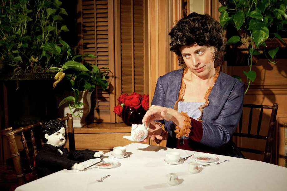 """Jody Flader, who plays Elsie de Wolfe in Stolen Chair Theatre Company's latest production """"The Bachelors' Tea Party,"""" fills the cup of one of her 'guests.' The show, which is running at Lady Mendl's Tea Salon in New York City, is the 15th original work of the theater company, which was launched in 2002 by Kiran Rikhye and Jon Stancato, a 1998 graduate of Greenwich High School. The show runs on Sundays, through July 15, 2012. For more information on tickets, visit www.stolenchair.org or call 212-410-2830. Contributed photo/Carrie Leonard Photo: Contributed Photo"""
