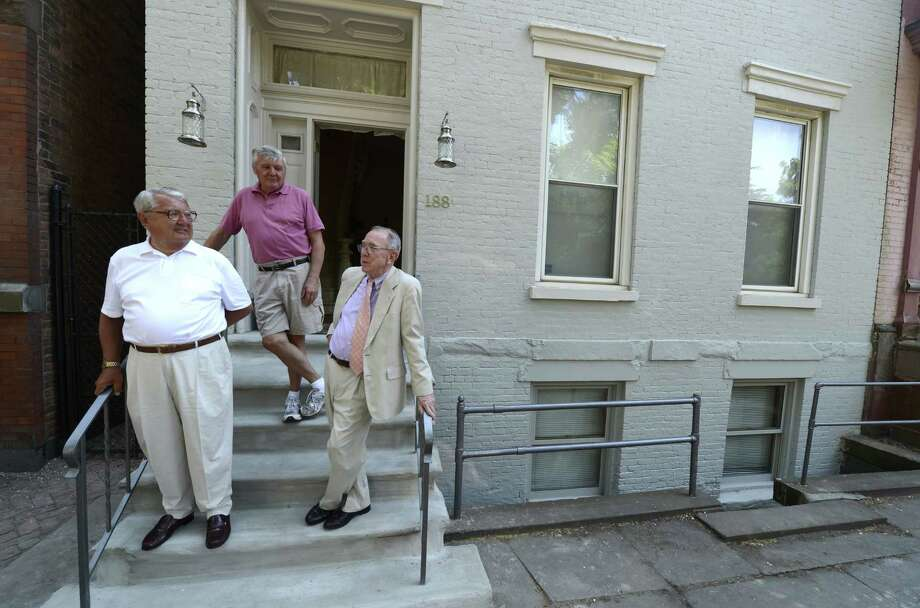 Jack Stapleton, actress Maureen Stapleton's brother, left, Bill Stanton, center, and Redmond Griffin, right, who are both cousins, stand in front of the family home at 188 1st Street in Troy, N.Y. June 21, 2012. The occasion was a tribute to Troy native and Oscar Award winning actress Maureen Stapleton by a partnership of Troy Little Italy, Rensselaer County Historical Society and Russell Sage College. (Skip Dickstein/Times Union) Photo: Skip Dickstein / 00018197A