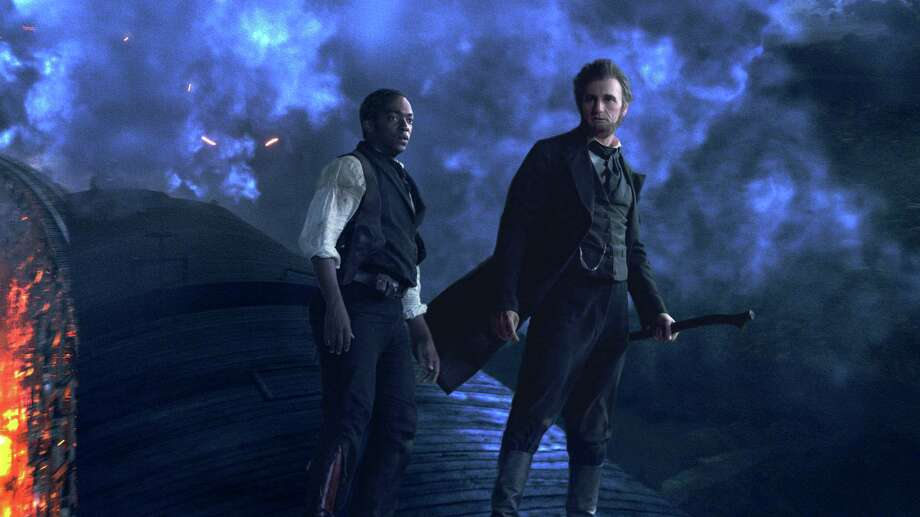 Abraham Lincoln (Benjamin Walker, right) and his closest friend Will Johnson (Anthony Mackie) make their final stand atop a speeding train. Photo: Courtesy Twentieth Century Fox Corp. Photo: Photo: Courtesy Twentieth Century Fox Corp. / TM and © 2012 Twentieth Century Fox Film Corporation. All rights reserved. Not for sale or duplication.