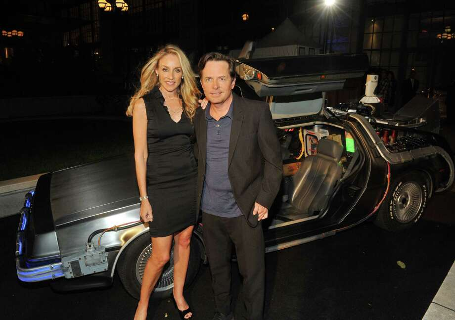 ** COMMERCIAL IMAGE ** In this photograph taken by AP Images for Universal Studios Home Entertainment - Tracy Pollan, left, and Michael J. Fox at the Back to the Future 25th Anniversary Trilogy Blu-ray / DVD  reunion and launch party, Monday, Oct. 25, 2010, in New York, hosted by Universal Studios Home Entertainment. (Diane Bondareff/AP Images for Universal Studios Home Entertainment) Photo: Diane Bondareff / AP IMAGES