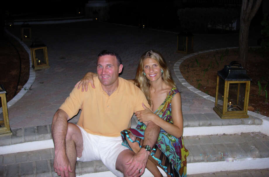 Timothy and Doris Hanley of Newtown have been married for 21 years and have three sons. Here, they enjoy some time together on vacation in 2007. Photo: Contributed Photo