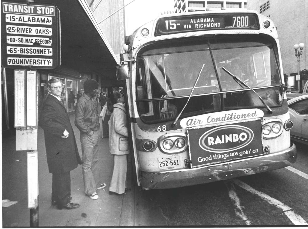 Bus riders climb into the air-conditioned HouTran bus to route 65-Bissonnet in 1977.