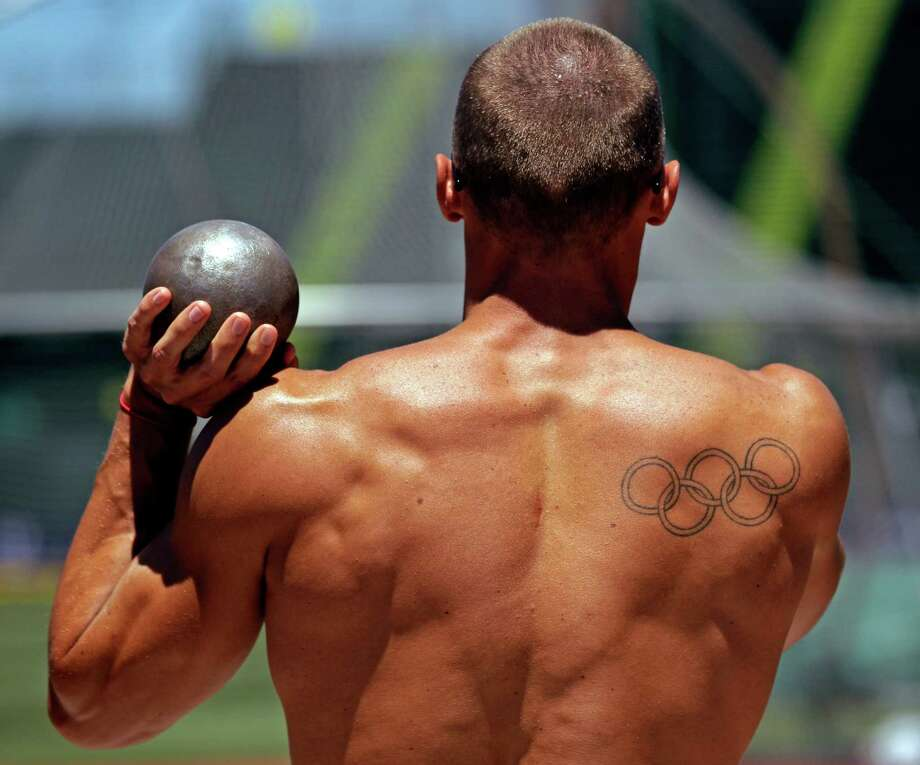 Decathlete Trey Hardee of Birmingham, Ala., throws a shot putt as he warms up before at the U.S. Olympic Track and Field Trials Wednesday, June 20, 2012, in Eugene, Ore. Photo: Marcio Jose Sanchez, Associated Press / AP