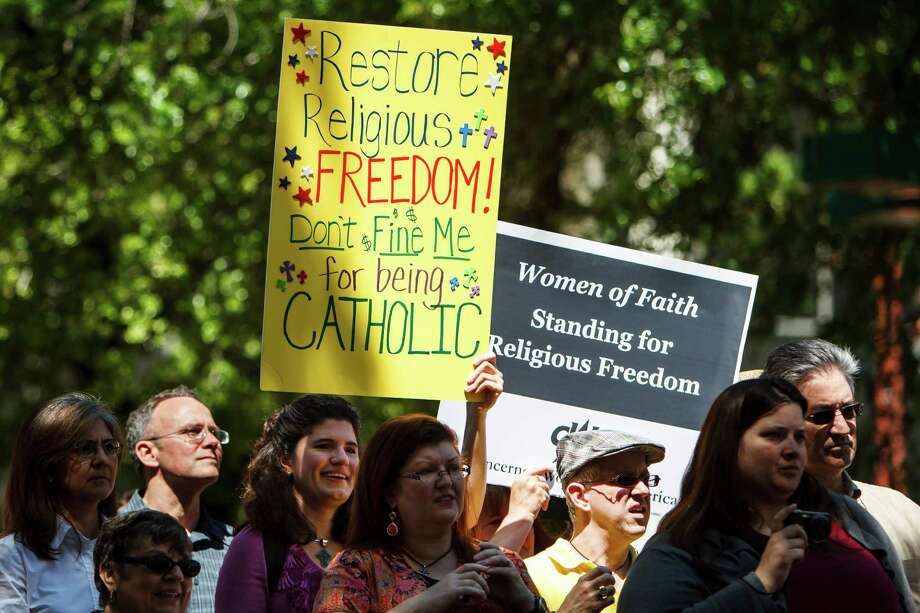 Katherine Krehbiel holds a sign during the Stand Up for Religious Freedom rally where hundreds of Catholics and others opposed to an Obama administration requirement that religious employers provide birth control coverage gather at Tranquility Park, Friday, March 23, 2012, in Houston.   The Stand Up for Religious Freedom event will happen in about a dozen cities in Texas and more than a hundred nationwide, including Washington D.C. Organizers say the rally is not about conception or abortion, instead a defense of religious freedom and First Amendment protections.   ( Michael Paulsen / Houston Chronicle ) Photo: Michael Paulsen / © 2012 Houston Chronicle