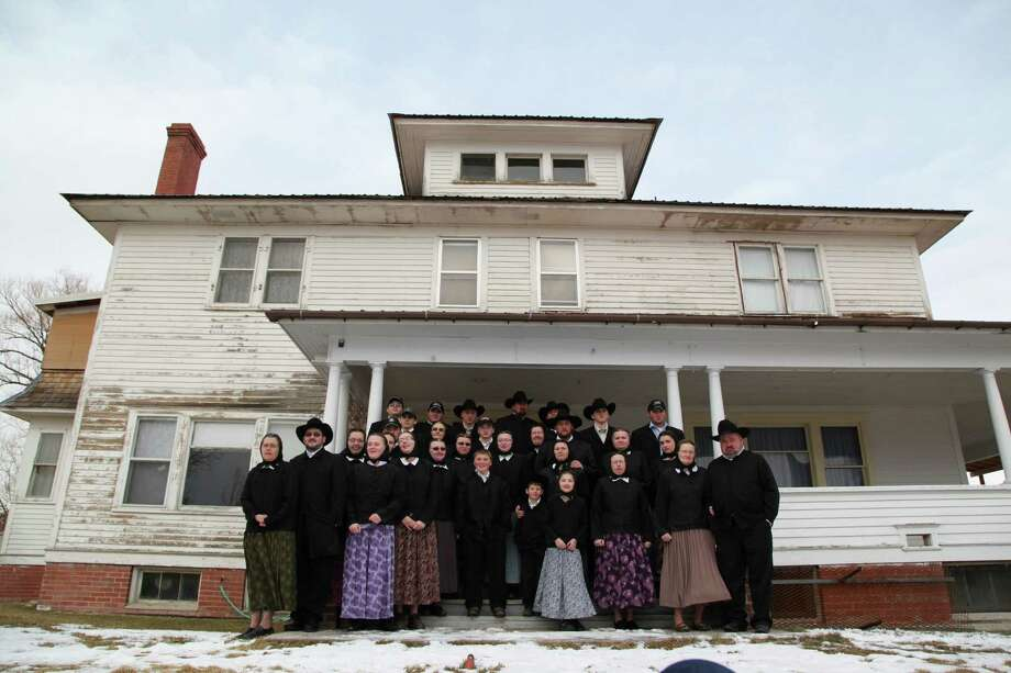 """This undated image released by National Geographic Channels shows a Hutterite family in  Lewistown, Mont. """"Meet the Hutterites,"""" is a National Geographic documentary series about a small religious colony in rural Montana. (AP Photo/National Georgraphic, Ben Shank) Photo: Ben Shank / Collins Avenue"""