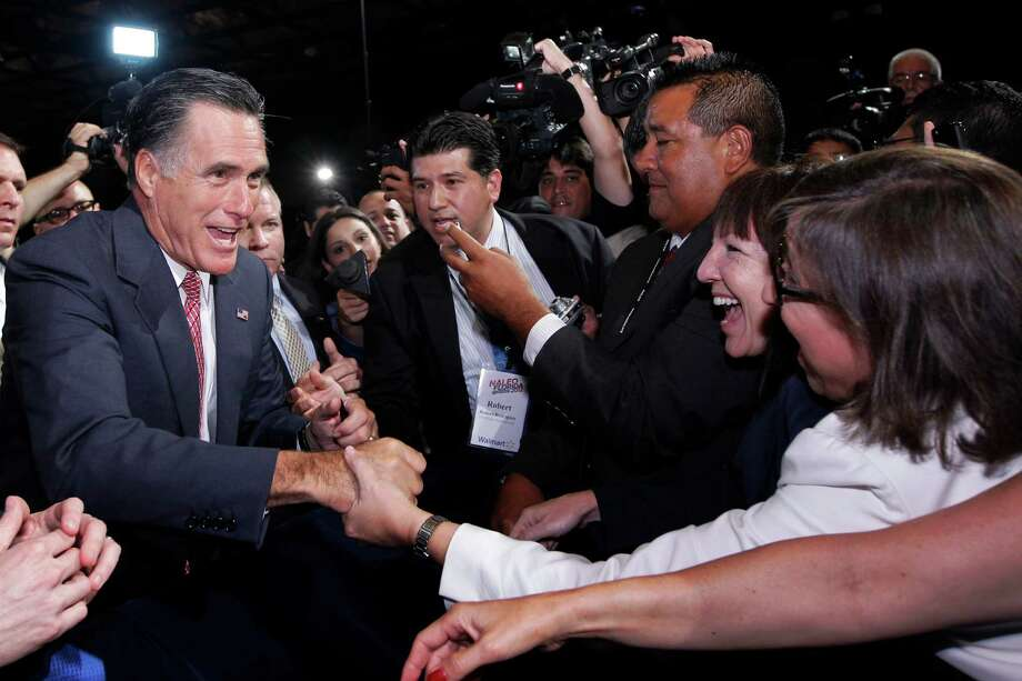 In a speech Thursday at the NALEO conference, Mitt Romney said he would issue more visas for legal immigration and grant citizenship to immigrants who serve in the military. Photo: Charles Dharapak, Associated Press