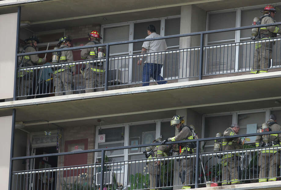 San Antonio firefighters gather on the seventh and eighth floors of the Victoria Plaza apartments after a small fire broke out in one of the apartment's bathrooms. Some residents were evacuated and according to traffic on the fire scanner the fire was extinguished with tap water. Photo: John Davenport, San Antonio Express-News