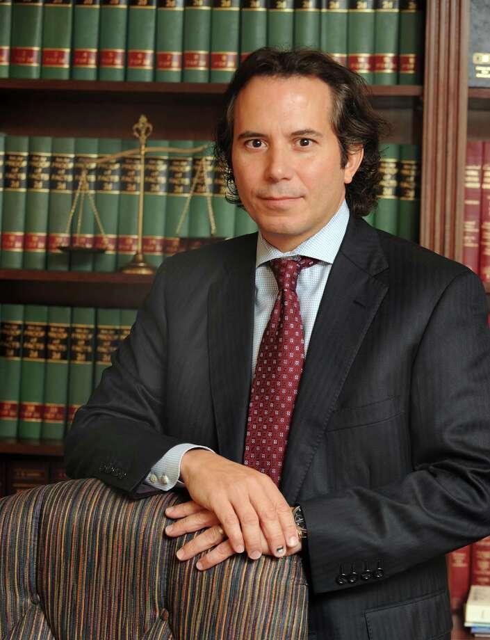 Danbury attorney Agostinho Ribeiro is photographed in his Danbury office, Wednesday, Sept. 15, 2010. Photo: Carol Kaliff, ST / The News-Times