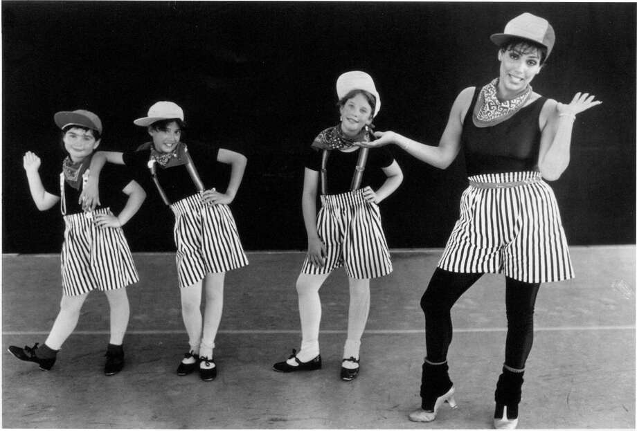 June 25, 1987: Hoofing it at the Stamford Festival for the Arts were, from left: Ashley Douglas, 9; Lisa BelloFiore, 10; Cindy Lash, 11; and instructor Doreen Thompson. The group was called Theater By and For Children. They performed a number called ìThe Curley Shuffle.î Photo: File Photo