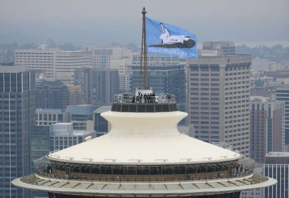 A Museum of Flight flag flies on the Space Needle on Sept. 29, 2010, during the city's bid for a retired space shuttle.  (Joshua Trujillo / seattlepi.com)