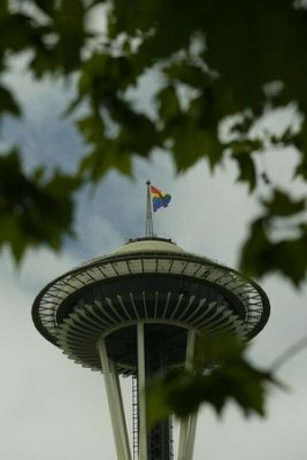 A gay pride flag waves from atop the Space Needle on June 26, 2010.   (Grant M. Haller)