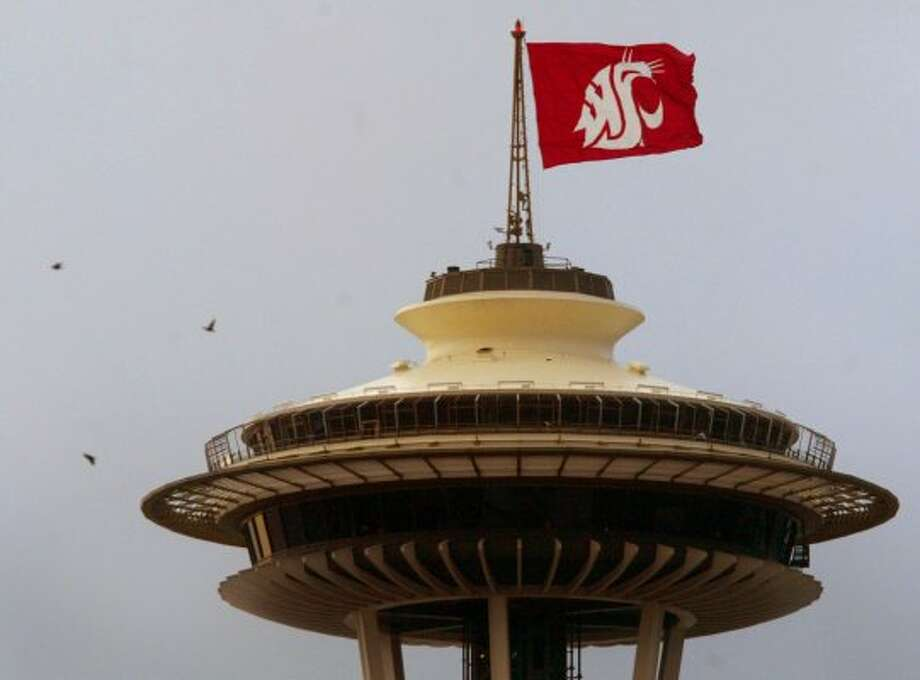 Washington State University's Cougar flag flies on the Space Needle on Nov. 2, 2005, as part of a fundraising rivalry with the University of Washington for Habitat for Humanity.   (Joshua Trujillo / Seattle Post-Intelligencer)