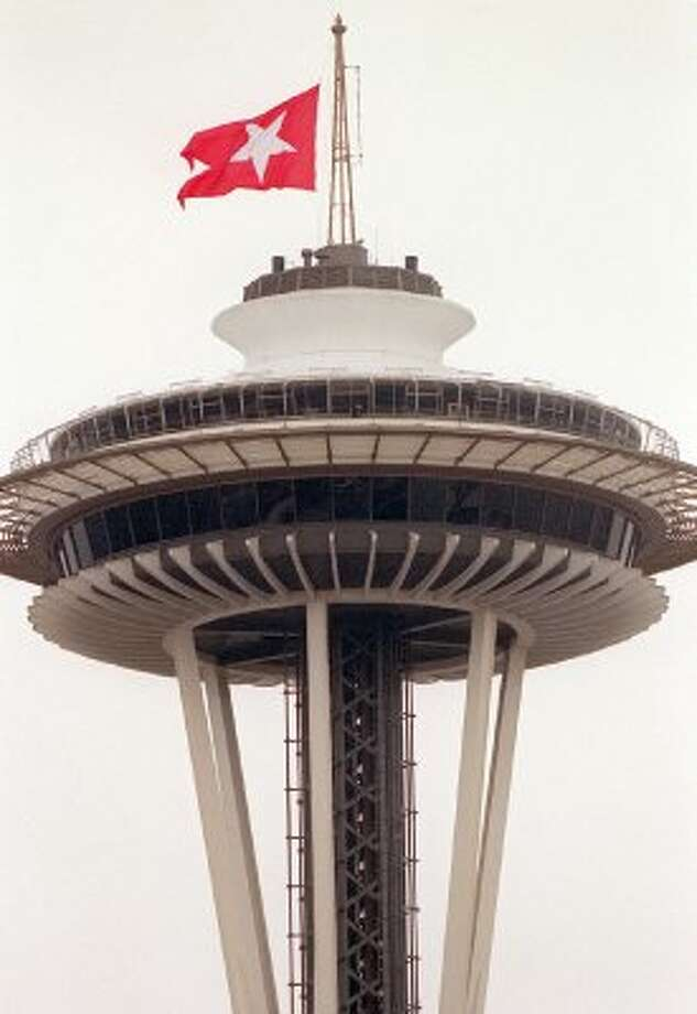 A replica of the Titanic's White Star Line flag flies at half-staff on the Space Needle, during a moment of silence at the Pacific Science Center's Titanic exhibit for the steamship victims on April 12, 2001.   (SEATTLE POST INTELLIGENCER)