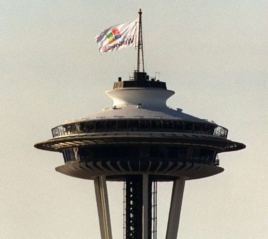 A Microsoft publicity flag flies over the Space Needle on Feb. 13, 2001.
