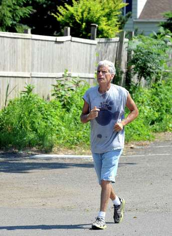Bob Ginty, 60, of New Milford, passes through Rogers Park in Danbury on a seven and a half mile run Thursday, June 22, 2012. Photo: Michael Duffy / The News-Times