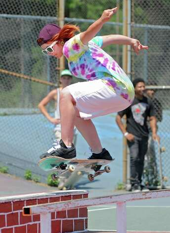 Victoria Vigliotti, 18, of Schenectady performs a trick on a skateboard over a rail during a contest in Washington Park Thursday, June 21, 2012 in Albany, N.Y. Thursday was national skateboard day. (Lori Van Buren / Times Union) Photo: Lori Van Buren