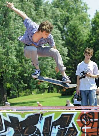 "Jordan Purcell, 18, of Rotterdam performs an ""ollie"" over a rail on his skateboard during a contest in Washington Park Thursday, June 21, 2012 in Albany, N.Y. Thursday was national skateboard day. (Lori Van Buren / Times Union) Photo: Lori Van Buren"