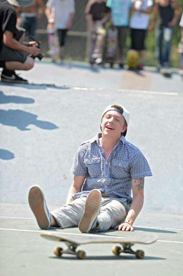 Jordan Purcell, 18, of Rotterdam wipes out while performing a trick on his skateboard during a contest in Washington Park Thursday, June 21, 2012 in Albany, N.Y. Thursday was  national skateboard day. (Lori Van Buren / Times Union) Photo: Lori Van Buren