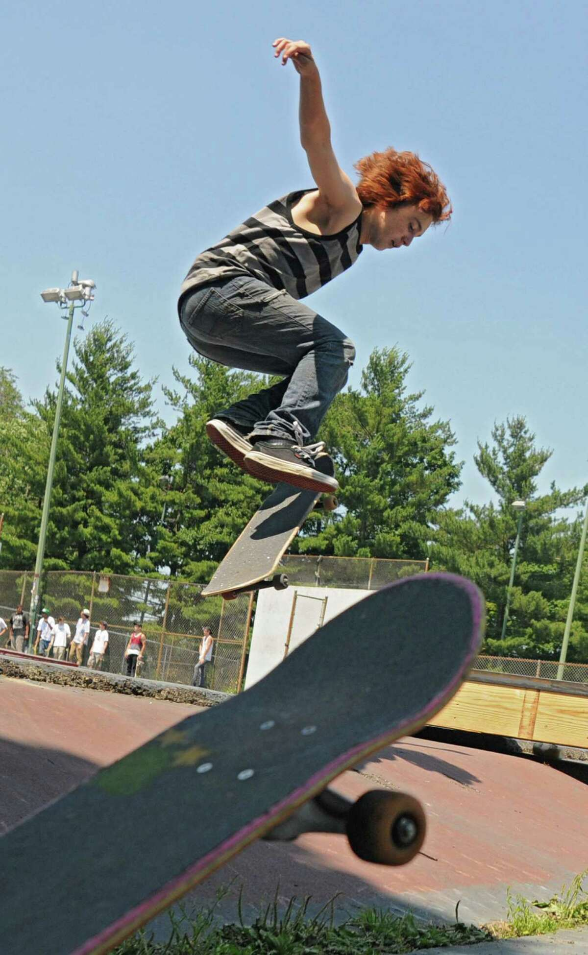 Mateo Gilchrist, 15, of Albany perfoms a trick on his skateboard during a contest in Washington Park Thursday, June 21, 2012 in Albany, N.Y. Thursday was national skateboard day. (Lori Van Buren / Times Union)