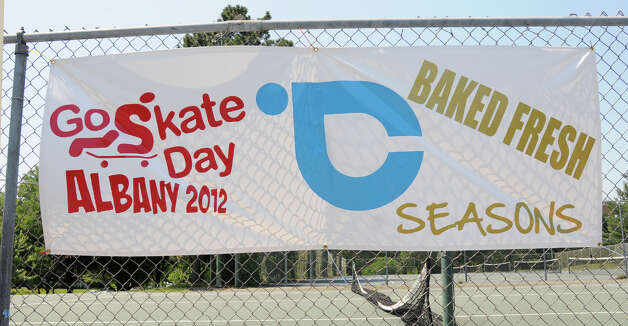 A sign hangs on a fence during a skateboard contest in Washington Park Thursday, June 21, 2012 in Albany, N.Y. Thursday was  national skateboard day. (Lori Van Buren / Times Union) Photo: Lori Van Buren