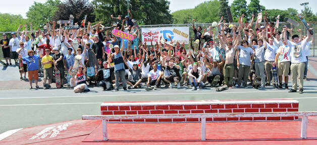 Skateboard participants gather for a group photo during a skateboard contest in Washington Park Thursday, June 21, 2012 in Albany, N.Y. Thursday was  national skateboard day. (Lori Van Buren / Times Union) Photo: Lori Van Buren