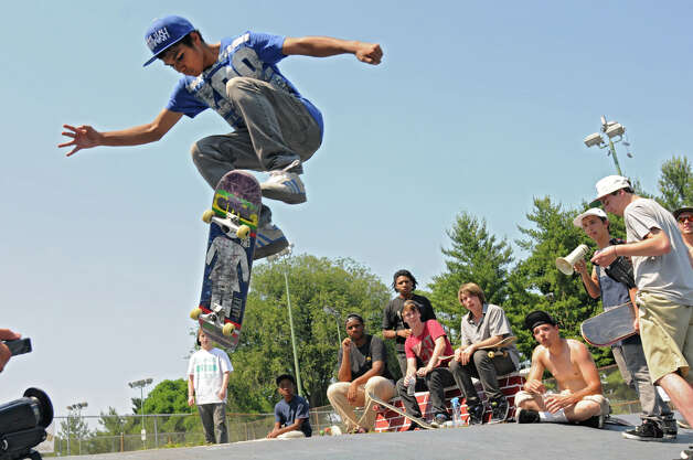 Alberto Clark, 16, of Schenectady performs a trick on his skateboard during a contest in Washington Park Thursday, June 21, 2012 in Albany, N.Y. Thursday was national skateboard day. (Lori Van Buren / Times Union) Photo: Lori Van Buren